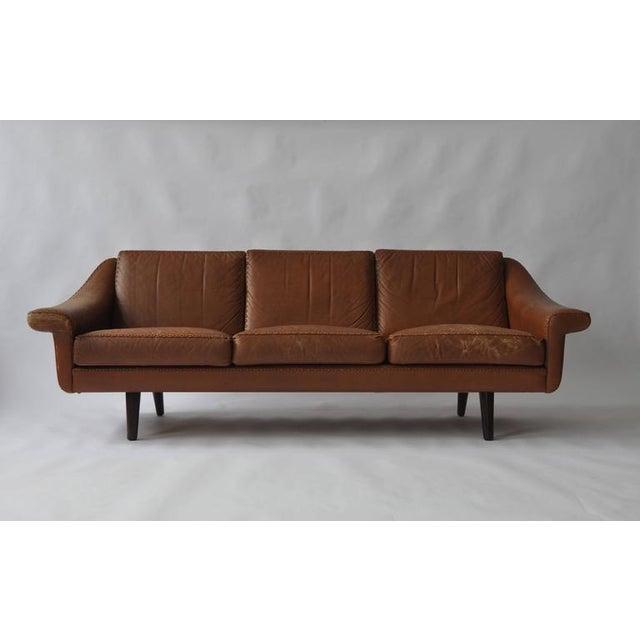 Aage Christiansen Danish leather sofa, 1960s. Teak legs.