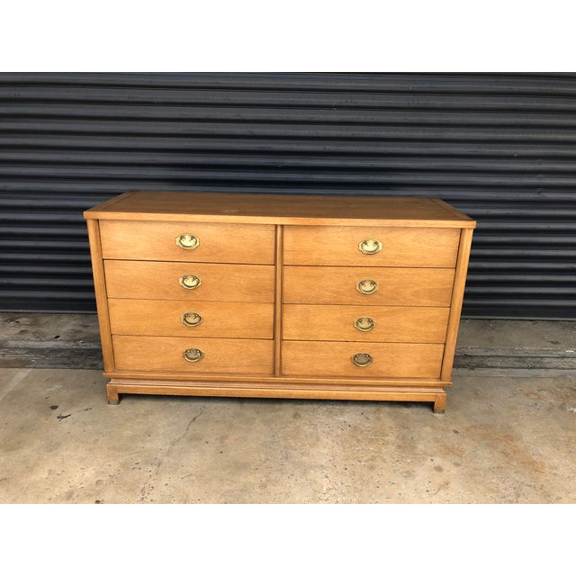 Mid century American of Martinsville dresser. A streamlined chinoiserie shape with brass hardware. This is a sturdy piece,...