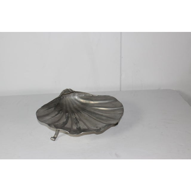 English pewter shell-shaped bowl. This three-footed piece would be a delicate catchall in an entryway or bedroom.