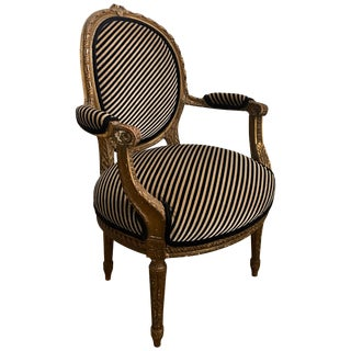 French Louis XVI Style Carved Giltwood Armchair With Modern Stripe Upholstery For Sale