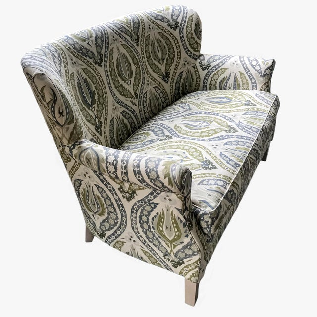 Loveseat, upholstered in a lotus print linen in blues and greens. Features a tight back, loose seat cushion, and exposed...
