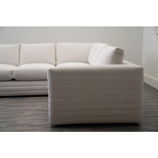 From the Evars Collective Manhattan custom upholstery collection. Channeled Frame. Upholstered in textured performance...