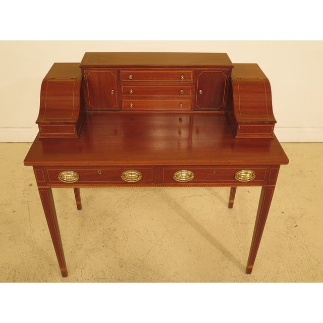 Kittinger Biggs Federal inlaid mahogany ladies writing desk. Dual marked. Features dovetailed drawer construction and...