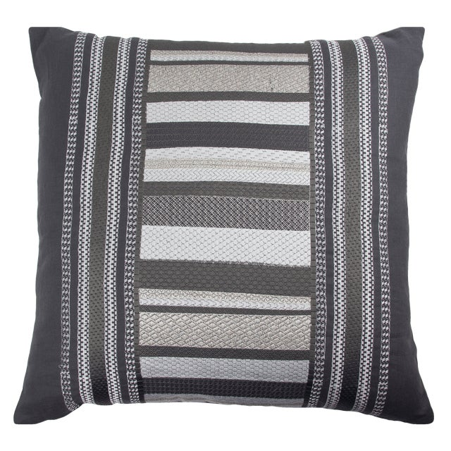 Grey, white, and silver metallic embroidered linen pillow. Solid grey velvet backing. 95% Feather 5% Down Insert. Made in...