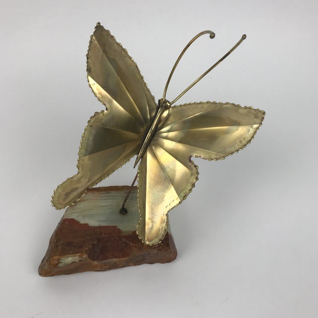 This butterfly actually flutters when you touch it. It is moulded from a beautiful piece of brass and mounted on the...