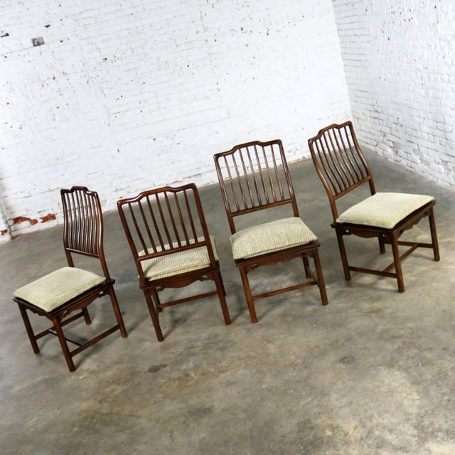 Handsome set of four Drexel Heritage Chinoiserie Ming style spindle back dining chairs with semi-loose cushion seats which...