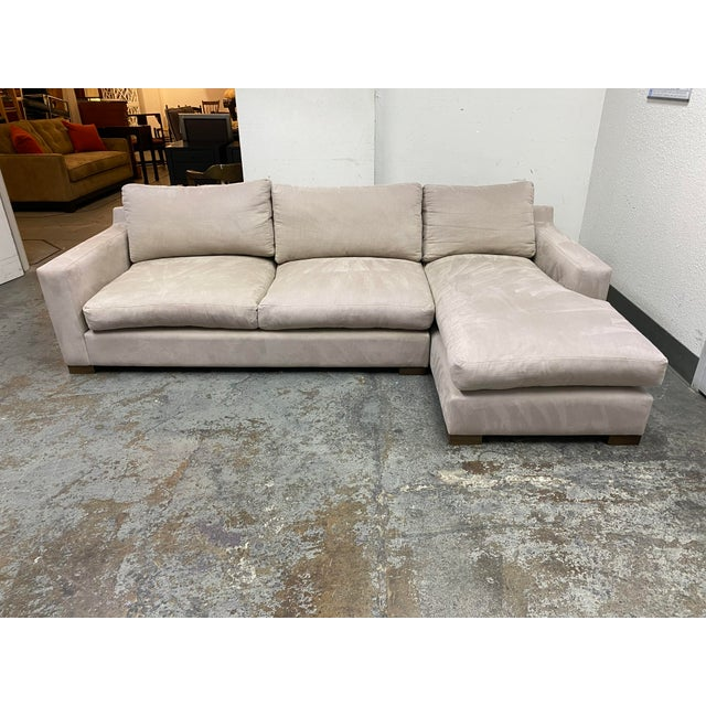 Design Plus Gallery presents a G Ramono Taupe Micro Fiber Down Filled Sectional. Soft taupe micro fiber upholstery has a...