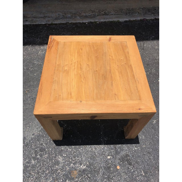 Natural elmwood side or end table with Ming style legs. Made in the early 21st century.
