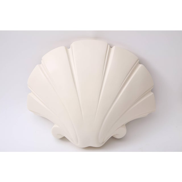 This pair of clamshell-form wall sconces were created by Sirmos and date to the 1970s-1980s. Note: These have been...