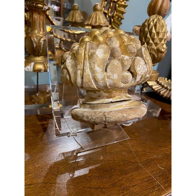 Antique artichoke shaped fragment on a custom lucite mount.