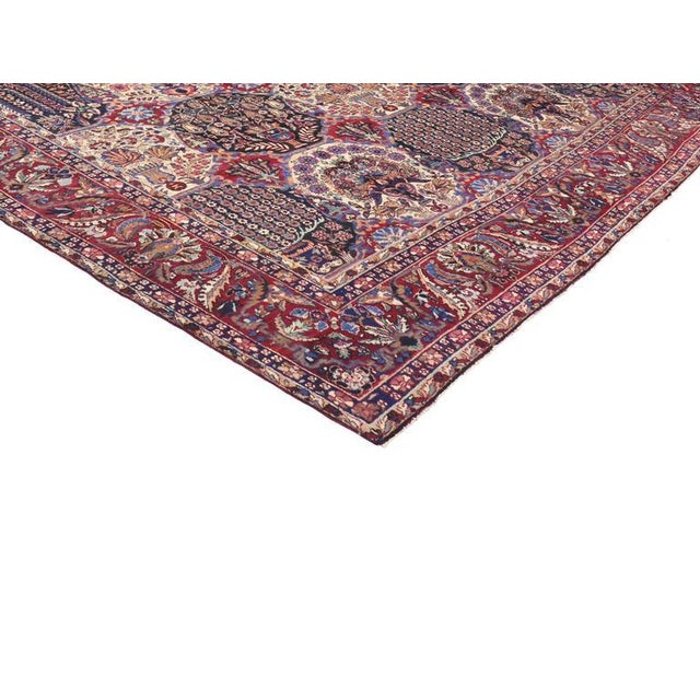 With its beautiful garden design pattern and jewel tone colors, this antique Persian Yazd rug is filled with meticulous...