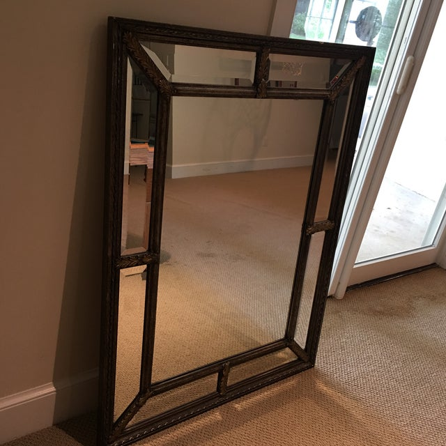 Silver and gold beveled mirror perfect for a hallway or dining room! This mirror features both Silver and gold tones. This...