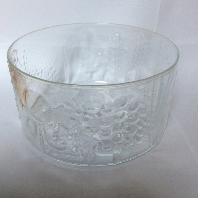 This is a fabulous vintage Iittala Finland glass bowl called Flora. It was designed by Oiva Toikka. The cool designs are...