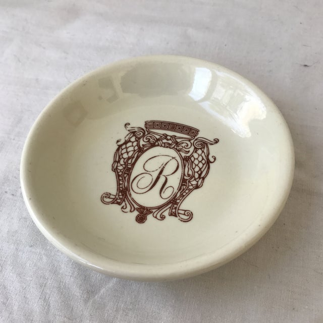 """Vintage petite dish with a center brown """"R"""" monogram. A great size for jewelry! In excellent vintage condition with minor..."""