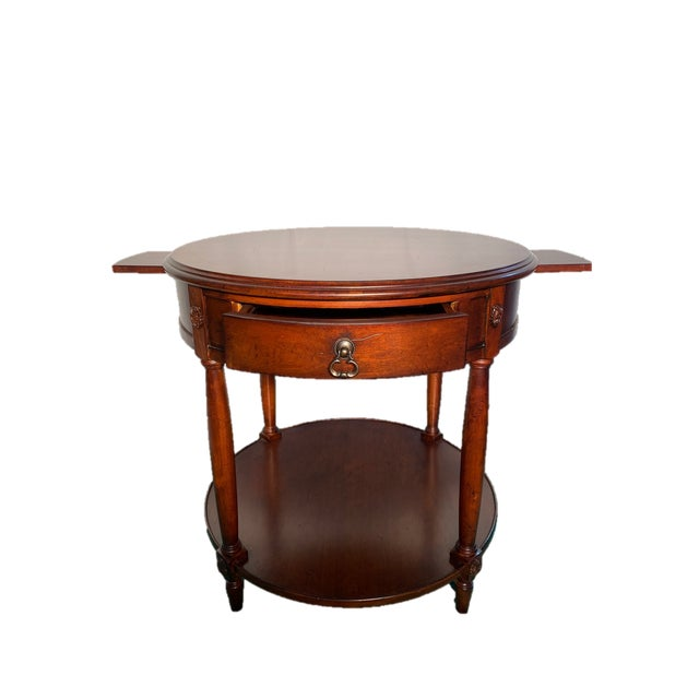 Pair of Vintage Drexel Heritage round side tables beautifully designed and extremely well maintained with no...