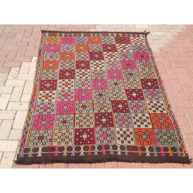 This beautiful, vintage, handwoven Kilim is approximately 60 years old. It is handmade of wool in all natural colors.. It...