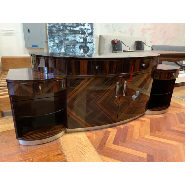 Design Plus Gallery presents a Curved Unit by Giorgio Furniture. From the Luna Collection. Crafted in Ebony Makassar with...