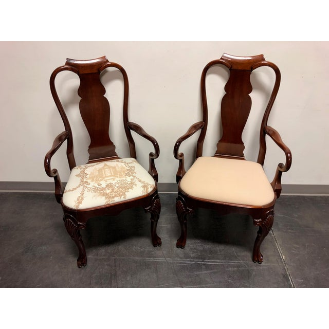 A pair of high-end dining chairs in the Queen Anne style. Made in the USA likely 1980s. Solid mahogany, carved knees,...
