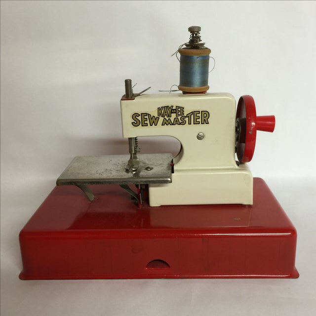 Kay an EE Sew Master made in post-war Germany in the 1940s. Marvelous sewing machine with working moving parts. Missing...