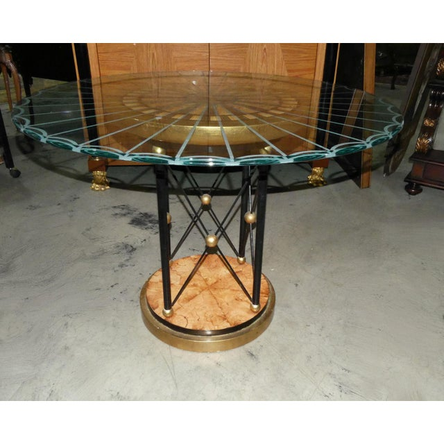 Custom made unique dining, accent, or center table. Masterfully crafted wood inlays in the plinth base as well as top. Top...