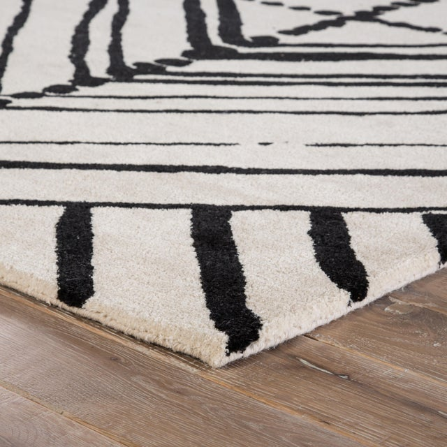 Bold and statement making, this hand-tufted area rug designed by Nikki Chu lends global modernity to chic spaces. A large-...