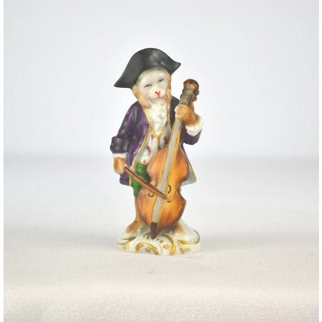 A charming porcelain monkey musician playing the cello. The hand painted details are so finite and detailed. Sitzendorf,...