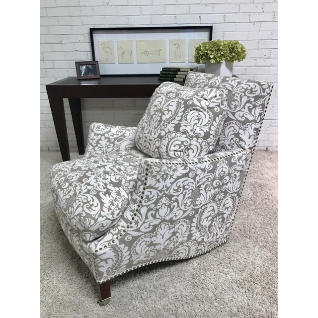 This custom RJones piece is beautiful and comfortable! Loose seat and back cushions, nail trim, tapered walnut legs with...