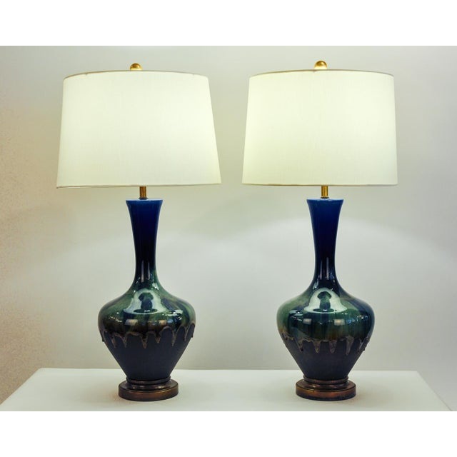 Vintage pair of porcelain table / task lamps with brass base. Each lamp is in excellent working condition. Each one...