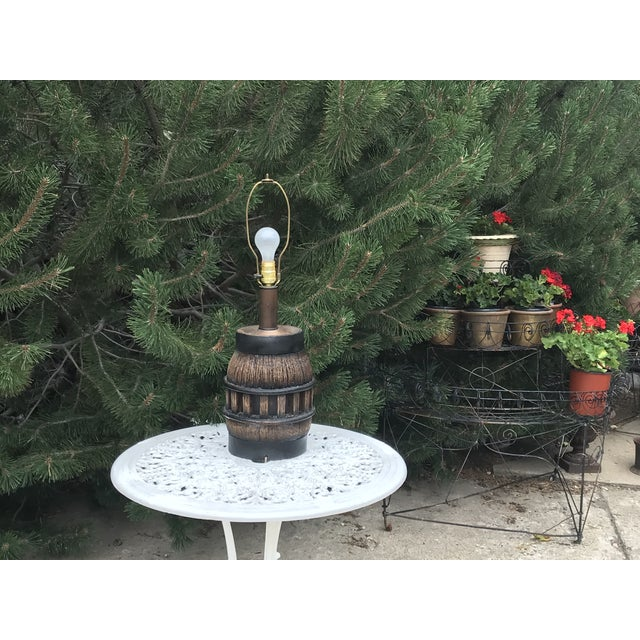 Original 19th century wooden wagon wheel hub repurposed into a lamp. Heavy weathered oak and iron banded and based. Base...
