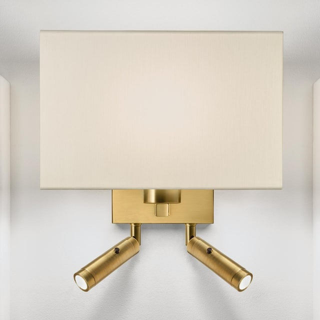 A brushed brass combination wall light with two LED reading lights with separate on/off buttons. Suitable for a twin bed....