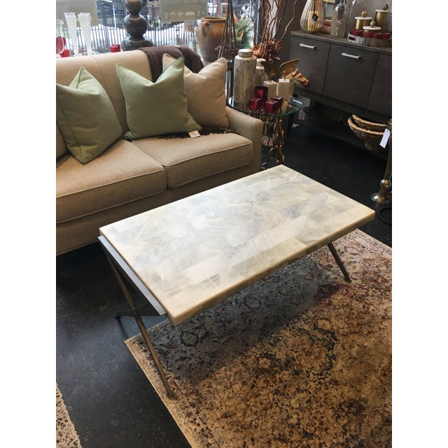 This stunning hand-forged iron base coffee table comes outfitted with a veneered onyx top. Perfect for any transitional to...