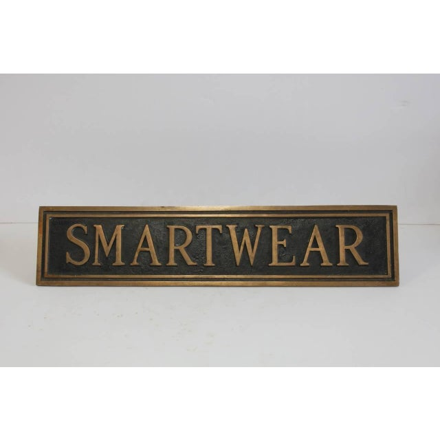 "Vintage brass department store sign ""Smartwear."""