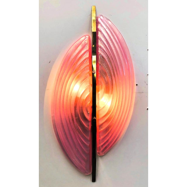 Italian wall light with two pink Murano glass half moons hand blown with textured ribbed patterns and mounted...