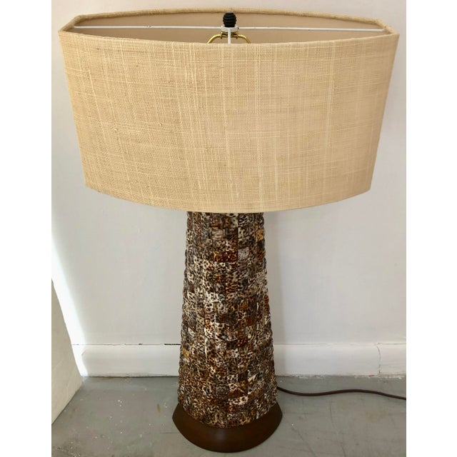 Stunning and very good quality mosaic shell table lamp with base and top in wood.Chic burlap shade. Tropical timeless...