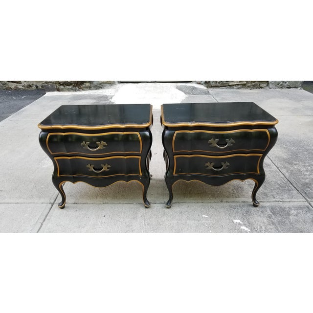 Very unique Bombay style wood painted night stands, or side tables,in a black satin finish with gilt trims and bronze...