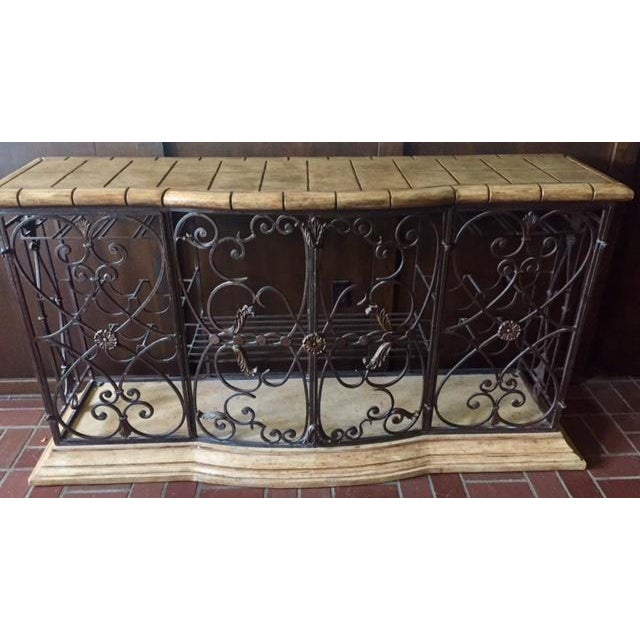 This beautiful Henredon Registry Console is very versatile. It has beautiful intricate wrought iron detail under the...