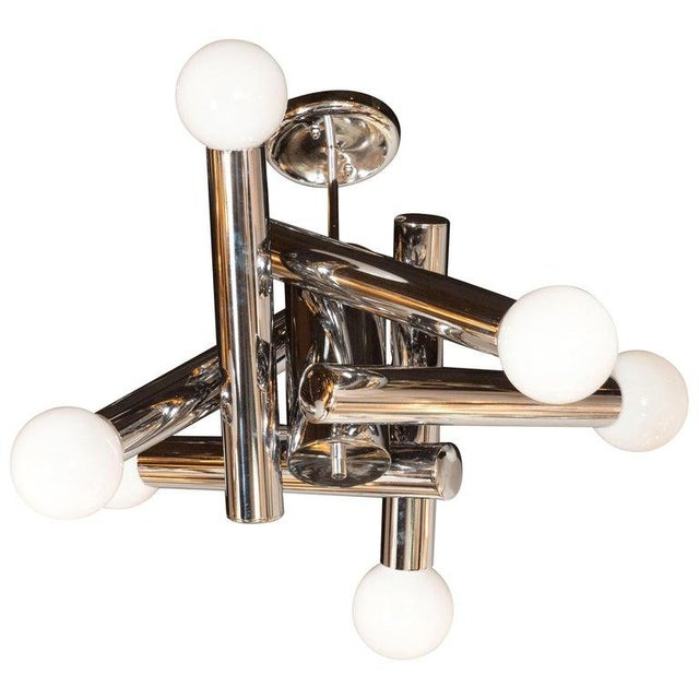 This stunning and sculptural Mid-Century Modern chandelier was realized in Italy by the legendary maker, Sciolari, circa...