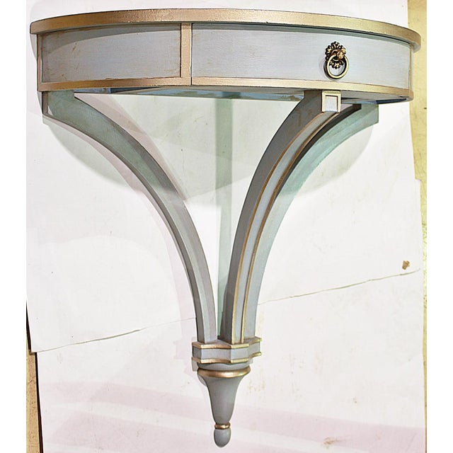 A rare find-a 1930s painted demi-lune mahogany hanging wall console/bracket with one drawer. Mounts with 4 screws to wall.