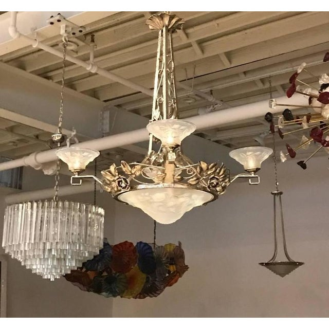 French Art Deco chandelier signed by P. Maynadier. With four opalescent glass shades surrounding a centre opalescent bowl...