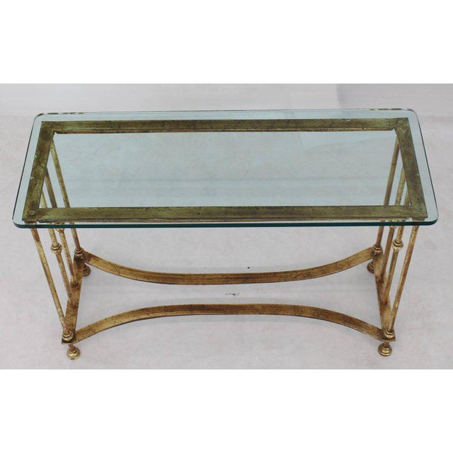 Gold gilt metal glass top console table.