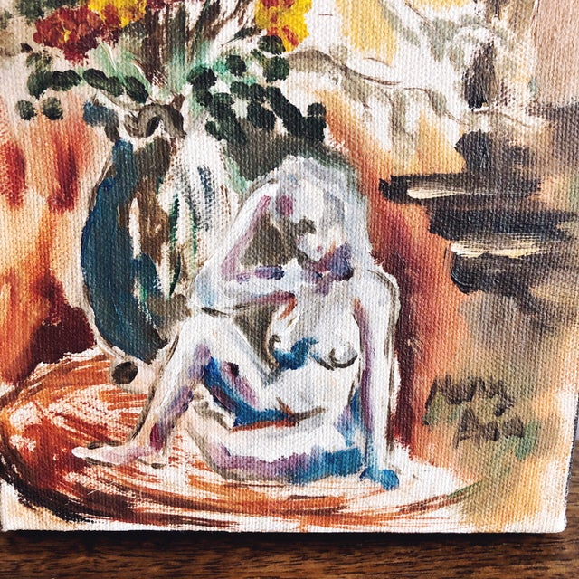"""Vintage small oil painting depicting a nude woman and florals. Lovely earth tones and detail. Signed """"Mary Ann."""""""