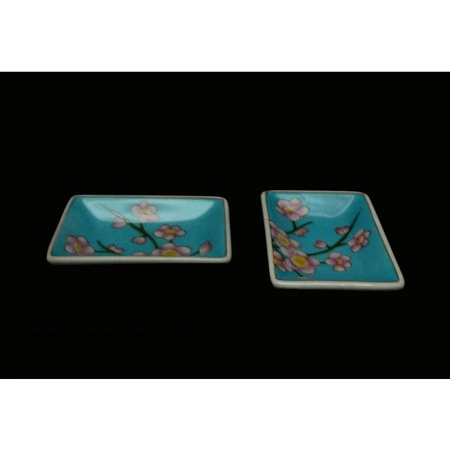 This is a nice handmade porcelain display dish with modern Asian graphics and color. ( not for cooking and food serving )...