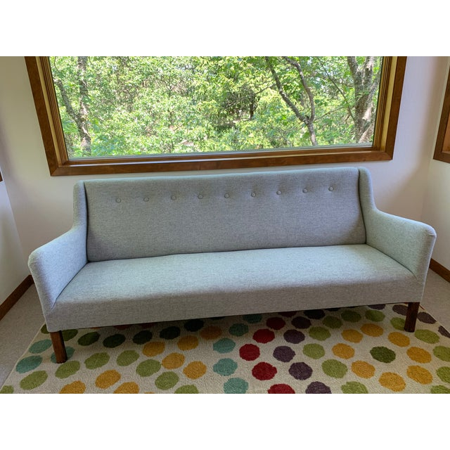 This is an elegant, newly reupholstered mid century modern sofa. All new wool fabric - Maharam Hallingdal in the tradition...