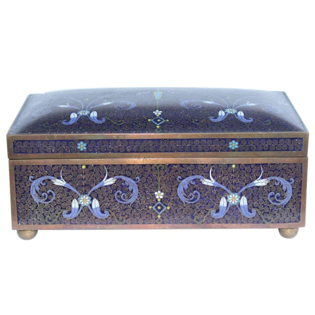 A Chinese or Japanese cloisonné box, possibly used for jewelry or small personal items.