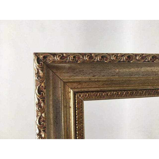 This pair of quality matching wood frames from Italy features ornate carvings and are painted with dark red and brown...