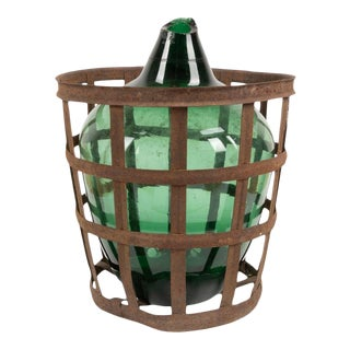 Antique French Green Glass Demijohn With Iron Basket For Sale