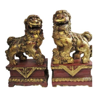 Carved Golden Foo Dogs - a Pair