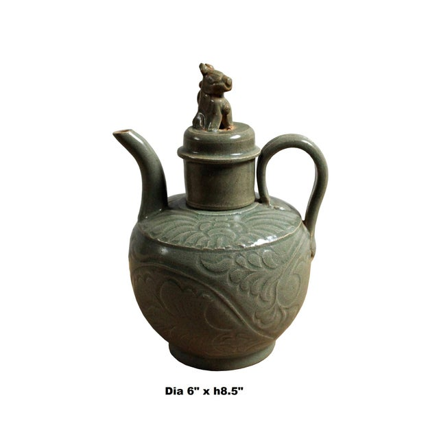 This is a handmade ceramic small jar with ancient outline style floral motif on the body. It has vintage gray greenish...