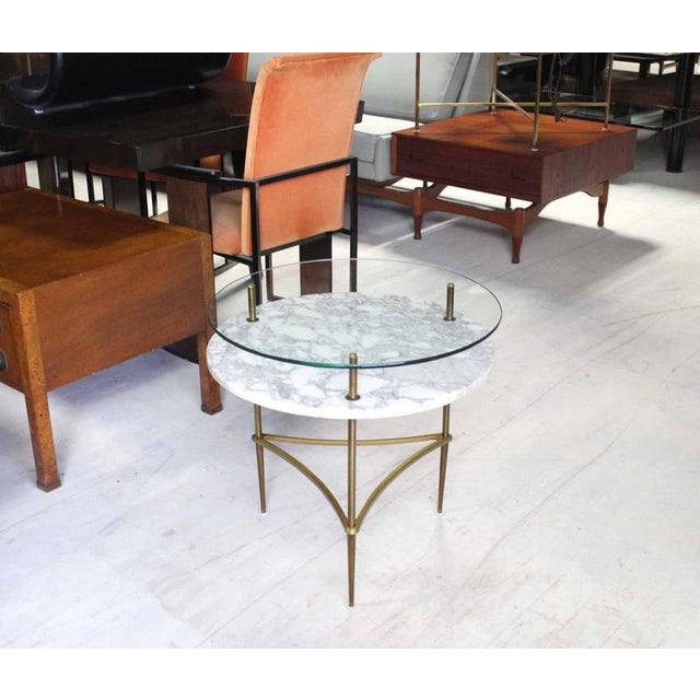 Round trip leg side table with beautiful brass stretcher and tempered legs.