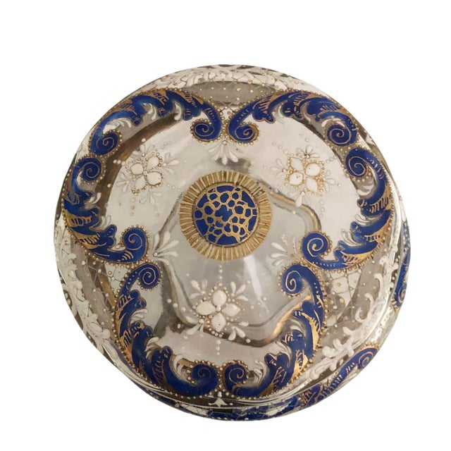 Round bohemian glass trinket box from the turn of the century with Brian's feet and hinges.